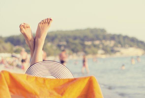 Woman's legs on the sea beach
